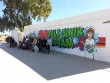 """""""7ell 3inik Jerada!"""" : Mur de graffiti à Jerada"""